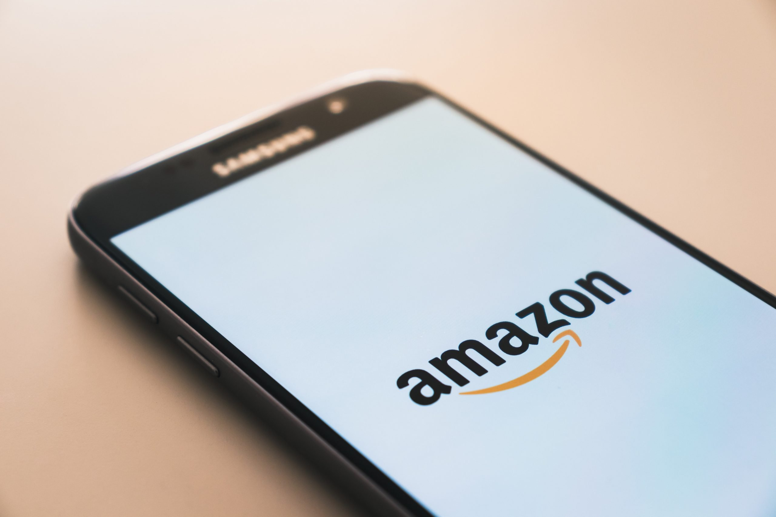 A phone with the amazon logo on it